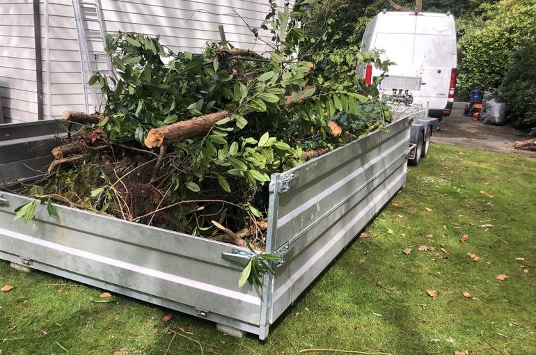 Opkuisen tuin en afvoeren groenafval 1