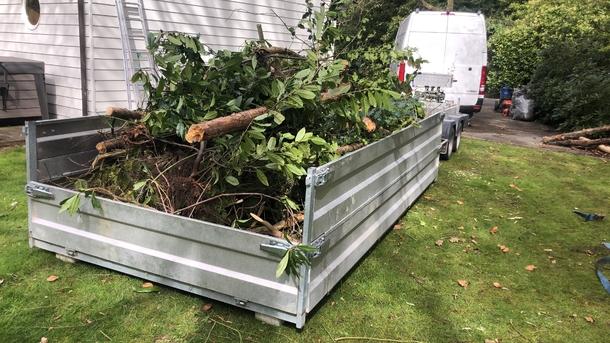 Opkuisen tuin en afvoeren groenafval